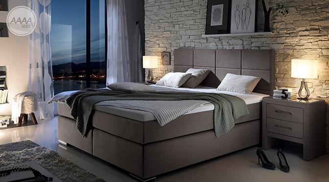 Łóżko z wysokim wezgłowiem i materacem strefowym